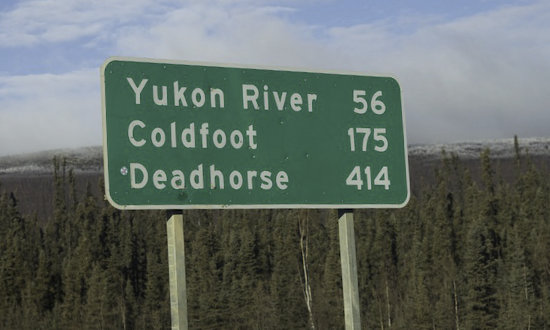 Sign along the Dalton Highway: Yukon River - 56 miles ... Deadhorse - 414 miles