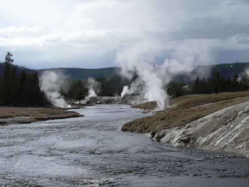 Geysers and steam vents along the river near Old Faithful at Yellowstone National Park